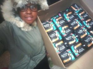 Yamkela with some of the sanitary pads that she has collected