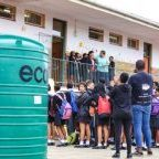 Water Tank delivery at Mary Waters School made possible by enke: Trailblazers - Photo Credit: Stephen Kisbey-Green